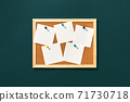 Empty cork board with blank notes on green background 71730718