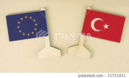 Flags of the European Union and Turkey made of recycled paper on the cardboard desk, flat layout 71731851