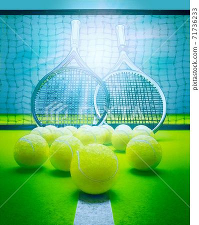 Tennis, rackets, near, a, yellow, balls, on, a, green, court 71736233
