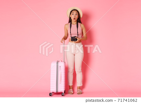 Tourism, summer vacation, holidays abroad concept. Full length of dreamy and amused asian girl traveller, tourist looking with amazement sideways, holding camera, want make pictures from journey 71741062