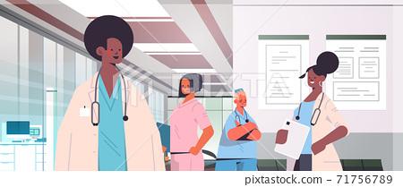 team of mix race doctors in uniform discussing during meeting in hospital corridor medicine healthcare 71756789