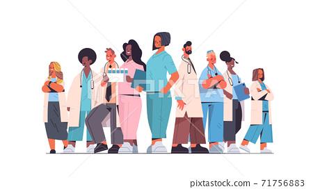 team of medical professionals mix race doctors in uniform standing together medicine healthcare concept 71756883