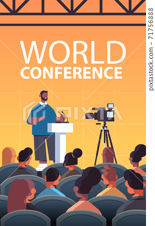 african american businessman giving speech at tribune with microphone on corporate international world conference 71756888