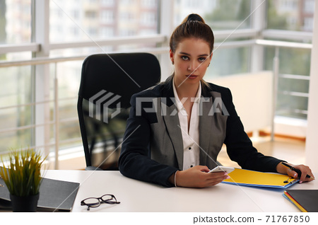 pensive businessman woman in jacket and office 71767850