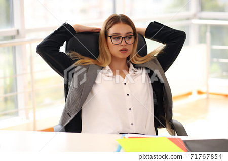 business lady at work. company manager. woman looking through documents in office. professional corporate dresscode 71767854