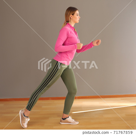 woman in fashionable sportswear. Dynamic movement. Side view. Sports and a healthy lifestyle 71767859