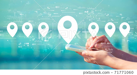Map pin concept with smartphone 71771060