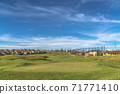 Golf course and homes with view of snow covered mountain peak in the distance 71771410