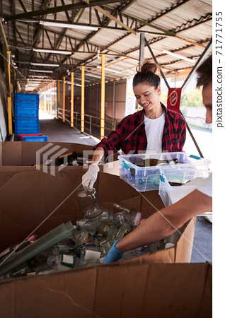 Woman holding plastic container with wastes 71771755