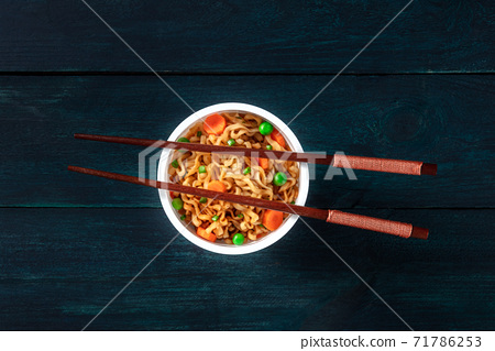 Ramen cup. Instant noodles with chopsticks, shot from the top 71786253