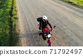 Woman biker riding driving motorcycle by country road, inspirational happy freedom hobby concept, aerial shot from drone above top 71792497
