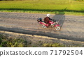Woman biker riding driving motorcycle by country road, inspirational happy freedom hobby concept, aerial shot from drone above top 71792504