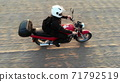 Woman biker riding driving motorcycle by country road, inspirational happy freedom hobby concept, aerial shot from drone above top 71792519