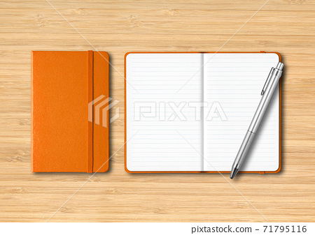 Orange closed and open lined notebooks with a pen on wooden background 71795116