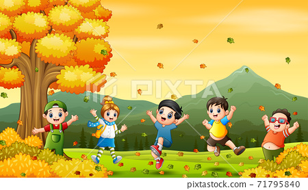 Cartoon Happy kids playing in autumn background 71795840