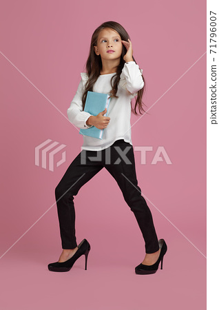 cute little child girl in oversized mother's shoes 71796007