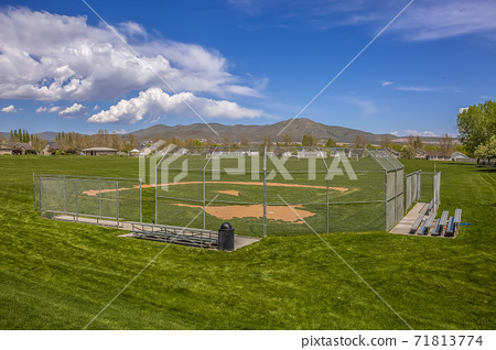 Softball or Baseball field with view of mountain and sky on a sunny day 71813774