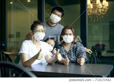 asian family wearing protection mask happiness at home 71815482