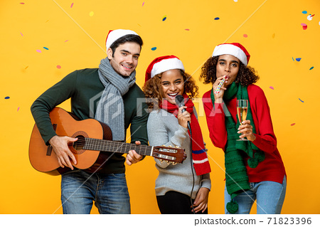 Happy diverse friends having party singing and celebrating Christmas 71823396