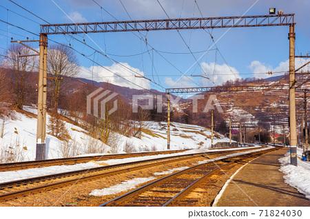 railway station in mountains. frosty winter landscape. transportation scenery 71824030