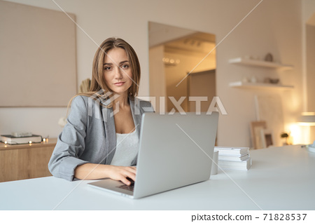 Beauitul young woman working using computer laptop concentrated 71828537