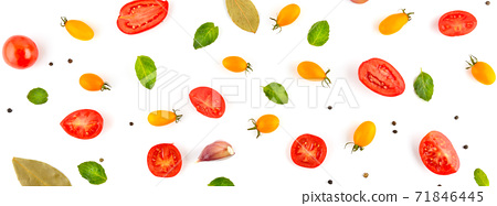 Bright background from cherry tomato, garlic, pepper and bay leaf. Vegetables isolated on white. Wide photo. 71846445