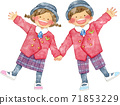 Children in uniforms holding hands with a smile 71853229