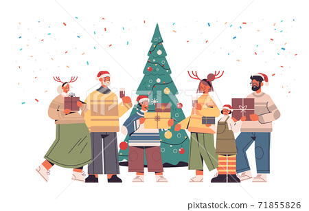 multi generation family in santa claus hats holding wrapped gift boxes happy new year and merry christmas holidays 71855826