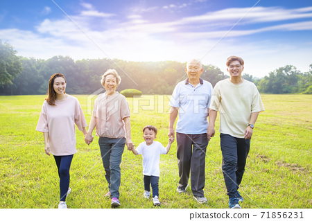 three generation asian family walking  in the park 71856231