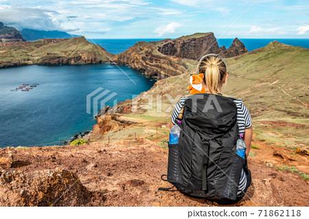 Girl enjoing View rocky cliffs clear water of Atlantic Ocean bay Ponta de Sao Lourenco, the island of Madeira, Portugal 71862118