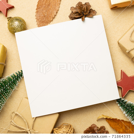 Empty memo paper with gift boxes and Christmas ornament on brown background. flat lay, top view, copy space 71864335