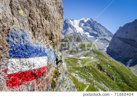Flag of france painted on a rock in French alps. 71868404