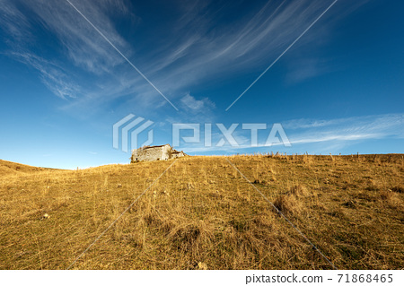 Meadow and Stone Farmhouse on Lessinia Plateau in Autumn - Veneto Italy 71868465