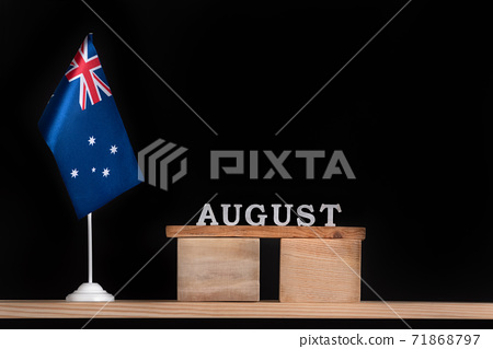 Wooden calendar of August with Australian flag on black background. Holidays of Australia in August. 71868797