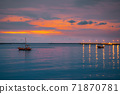 Sea views with boats and fish bridges at dusk. 71870781