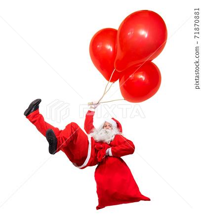 Funny flying Santa Claus falls with a bag full of x-mas gifts. Falling Santa holds air ballons. 71870881