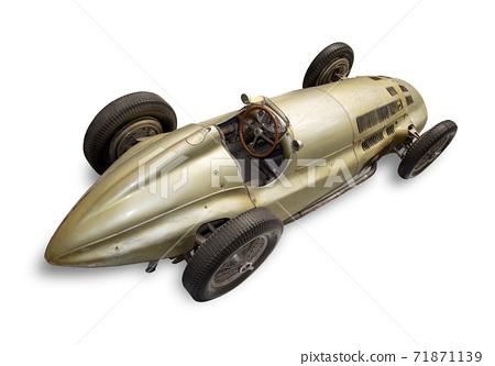 Historic race car, isolated on white background. Retro racing car with aerodynamic shape of bodywork 71871139