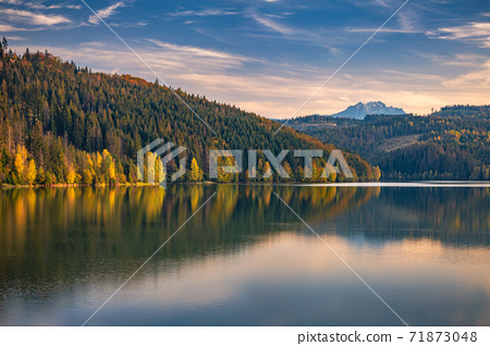 Autumn landscape with mountains on background. 71873048