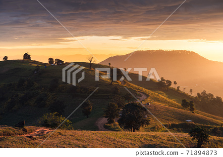 Sunrise on hill and tourists camping on vacation in national park 71894873