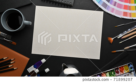 Designer workspace with mock up paper, water colour, paint brushes and stationery 71899207