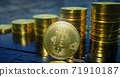 3d render of metallic bitcoin with rising columns of coins in background. 71910187