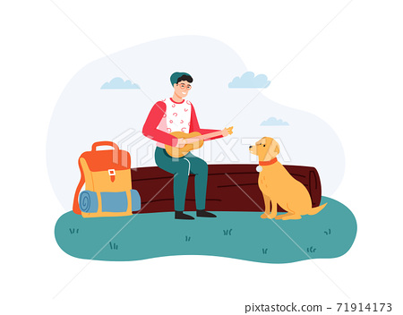 Boy sitting on log and playing guitar, dog sitting near hiker. Guy having summer trip leisure activity outside 71914173