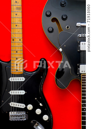 Electric Guitar on a red 71918060