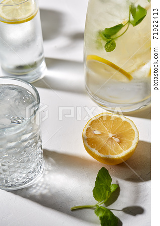 glasses with lemon water and peppermint on table 71922413
