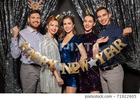 happy friends posing with new year banner 71922605