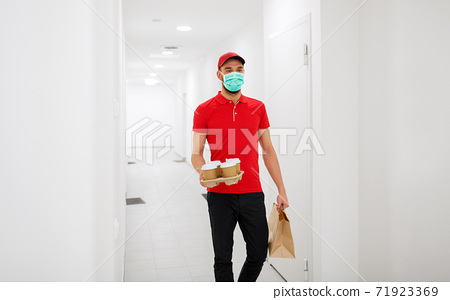 delivery man in mask with coffee and food 71923369