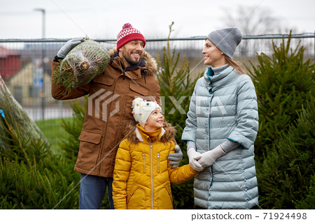 happy family buying christmas tree at market 71924498