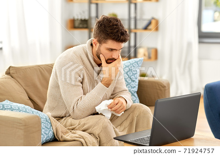 sick man having video call on laptop at home 71924757