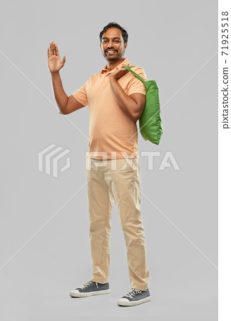 man with reusable canvas bag for food shopping 71925518