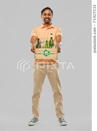 smiling young indian man sorting glass waste 71925532
